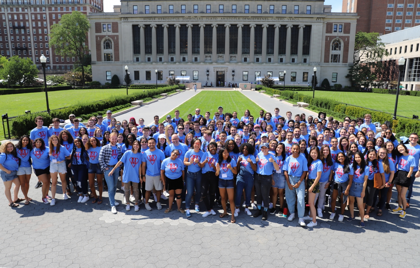 Group of student resident advisers and Residential Life staff in front of Butler Library
