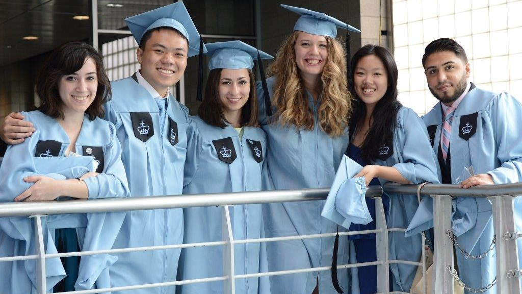 Columbia Engineering graduates smiling at the camera